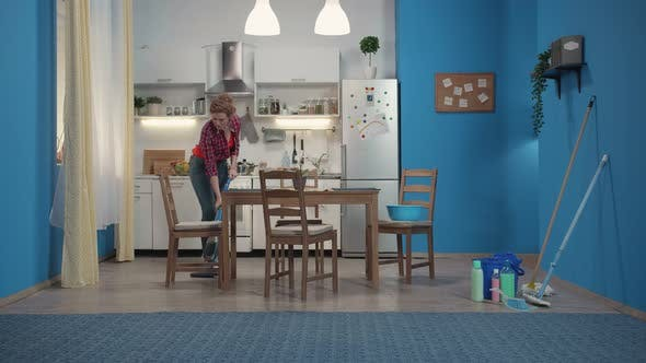 Thumbnail for Housewife Cleans Floor with a Blue Vacuum Cleaner
