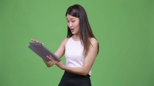 Young Beautiful Asian Businesswoman Using Digital Tablet