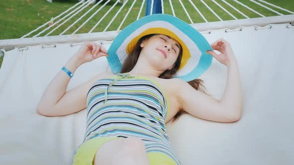 Thumbnail for An Attractive Young Woman Is Basking in a Hammock. Woman at the Concept