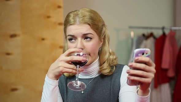 Thumbnail for Lady Calling Husband and Drinking Glass of Red Wine