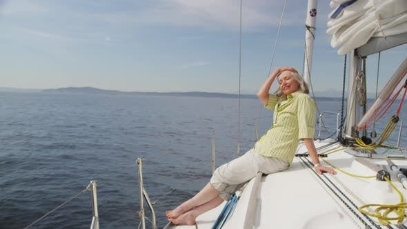 Thumbnail for Senior woman relaxing on sailboat. Shot on RED EPIC for high quality 4K, UHD, Ultra HD resolution.
