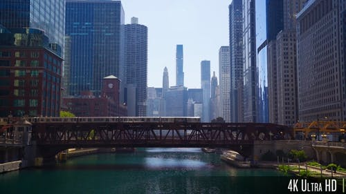 4K Downtown Chicago Skyline with Lift Bridges and Elevated L Train over the River