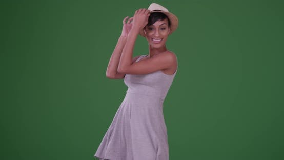 Thumbnail for Happy smiling black woman dancing on green screen