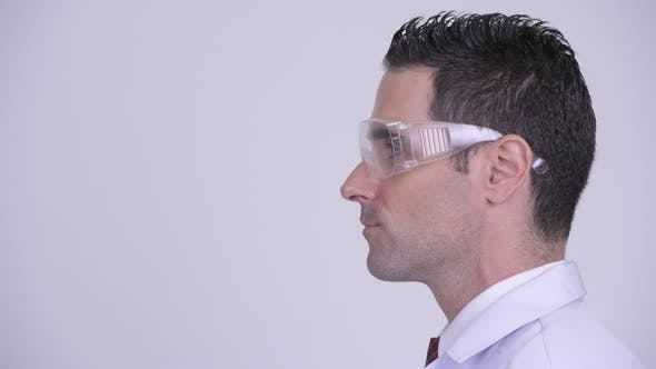 Thumbnail for Head Shot Profile View of Happy Man Doctor Wearing Protective Glasses Looking at Camera