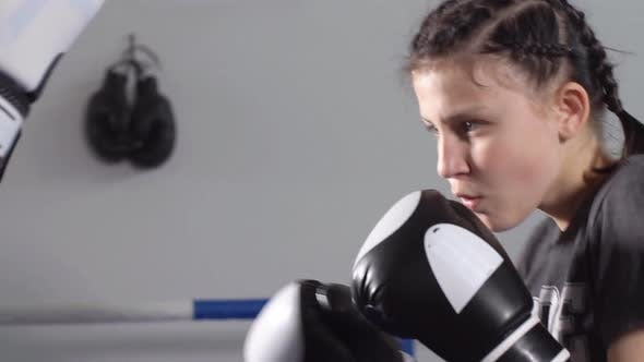 Thumbnail for Young Sporty Girl Gets Rapid Punches with Boxing Gloves. Slow Motion