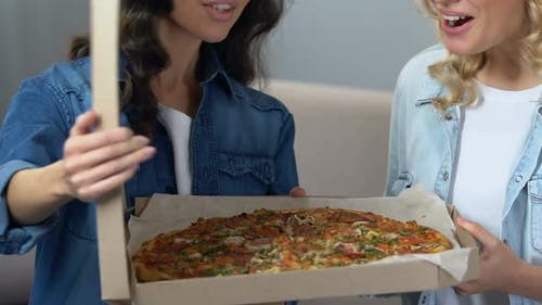 Cheerful Roommates Opening Box With Pizza, Girls Enjoying Aroma, Hen Party