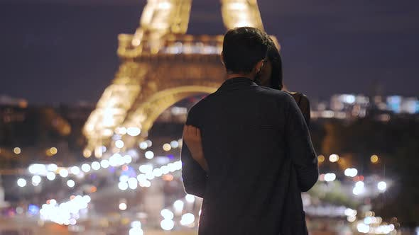 Cover Image for Romantic Couple in Love in Paris at Eiffel Tower in Night