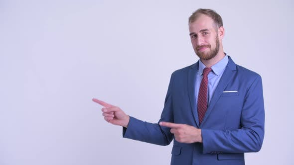 Thumbnail for Happy Bearded Businessman Pointing To the Side