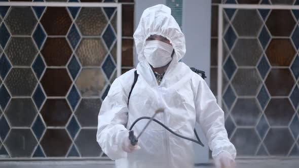 Thumbnail for Civil defense team in protective clothing disinfects workplaces as a coronavirus (Covid-19) measure