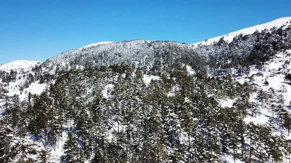 Thumbnail for Moving over a snow covered mountain on a clear day