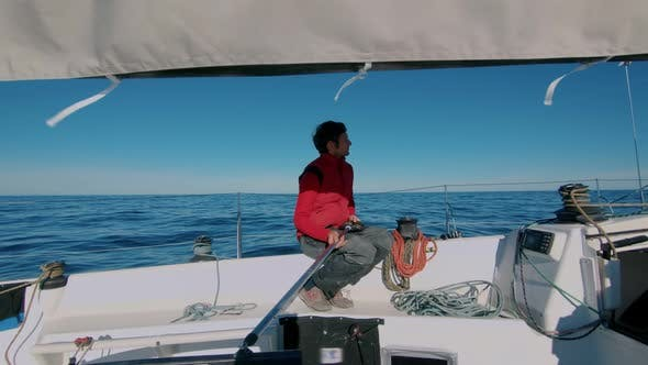 Thumbnail for Professional Yachtsman on Sail Boat in Sea