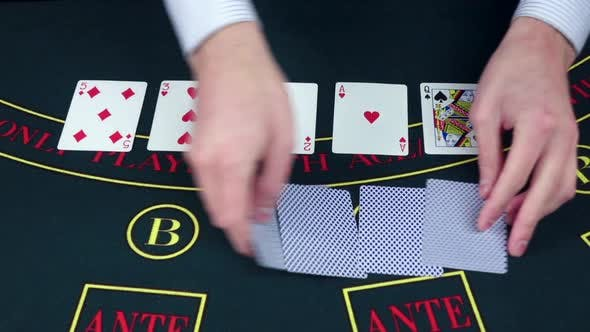 Thumbnail for Croupie Takes the Poker Cards on Green Table, Slow Motion