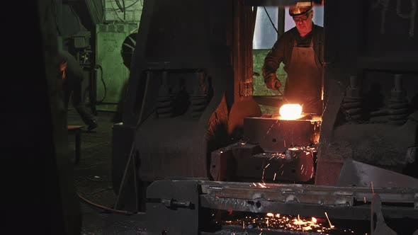 Forger Man Working With Hot Steel At Forgery Shop