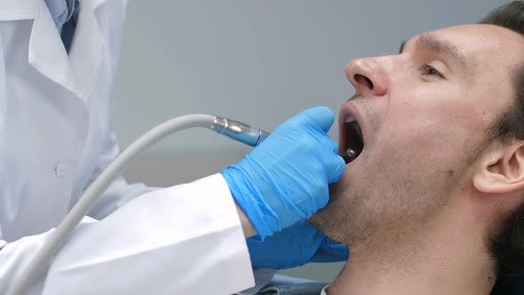 Thumbnail for Dentist with Drill Machine Treating Client