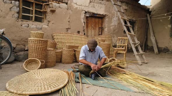 Thumbnail for Old Man Making A Basket With Bamboo