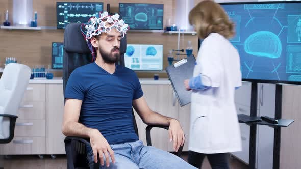 Patient with Brainwaves Scanning Headset Closing His Eyes