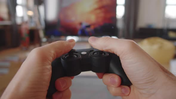 POV of Man Playing Video Game on TV at Home