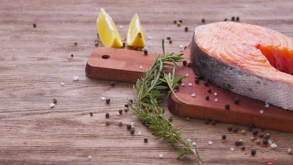 Raw, Fresh Salmon Steak on a Slate Board and Spices Around. Healthy Food Concept
