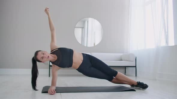 Thumbnail for The Brunette in the Apartment Does an Exercise Plank While Standing in a Static Position