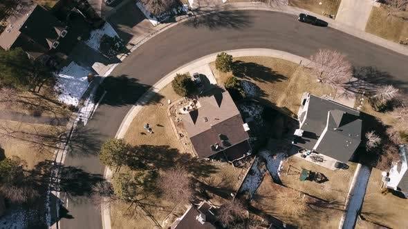 Aerial view of residential neighborhood in suburbia in snowless Winter