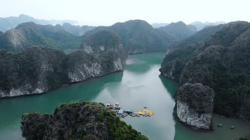 Aerial: flying over Ha Long Bay rock pinnacles, famous tourism destination in Vietnam