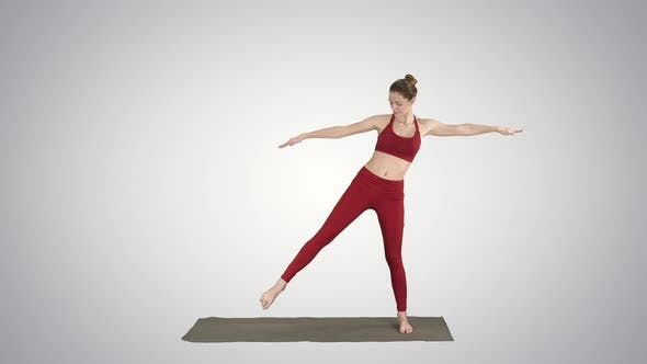 Thumbnail for Woman Practicing Yoga, Standing in Extended Side Angle Exercise, Utthita Parsvakonasana Pose on