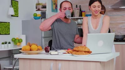 Happy Couple Surfing on Internet