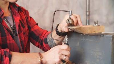 Jeweler Saws the Item at Workplace, Profession, Job