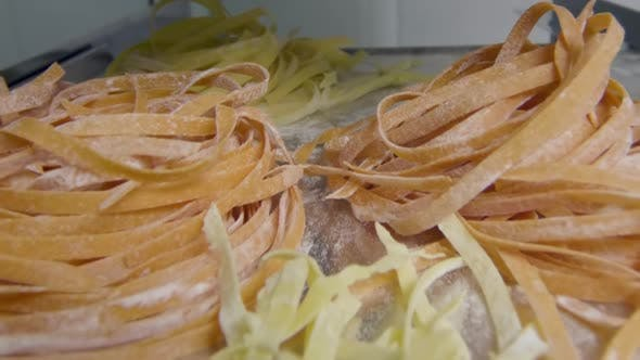 Thumbnail for Fresh homemade pasta on metal dish