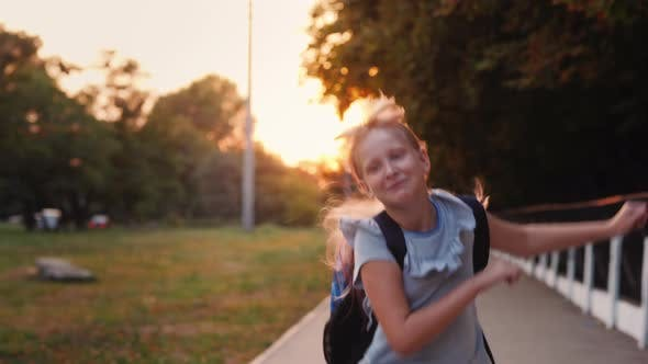 Thumbnail for Cheerful Child with a Satchel Behind His Back Runs Towards the Camera