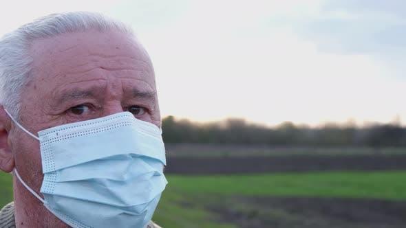 Grandpa in a Medical Mask in the Open Air