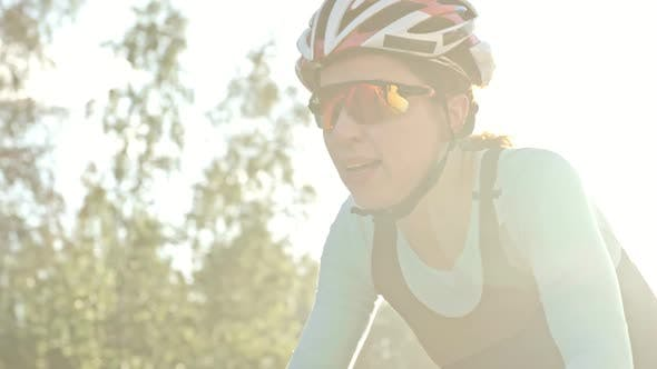 Thumbnail for Female Bicycle Racer Riding on Cold Day