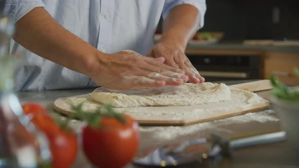 Thumbnail for Kneading and rolling fresh pizza dough
