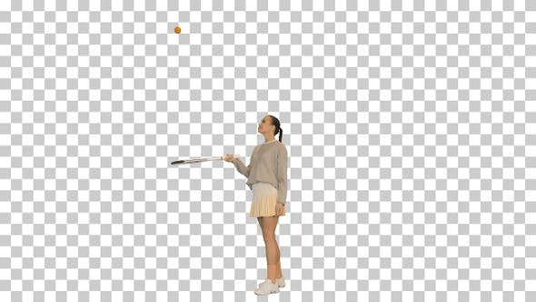 Young woman bouncing a ball on her tennis racket, Alpha Channel