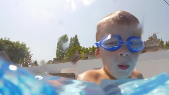 Thumbnail for Underwater Swimming of a Child in Goggles