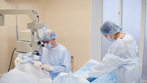 Doctor Performs Cataract Treatment of the Eye Nurse Helps the Ophthalmologist