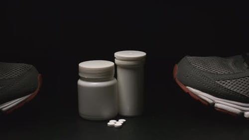 Dope: Plastic Containers, Pills And Sport Shoes