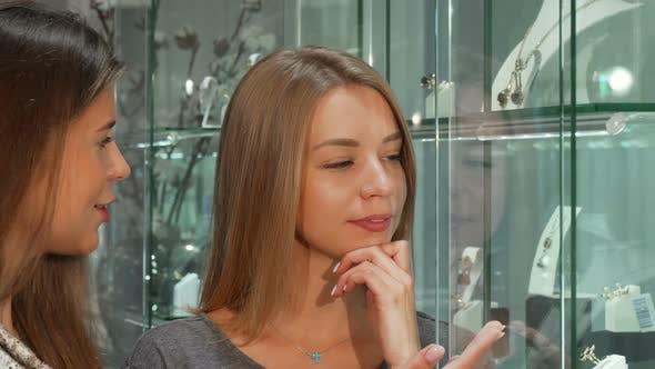 Thumbnail for Female Jeweler Helping Her Female Customer Choosing Jewelry To Buy