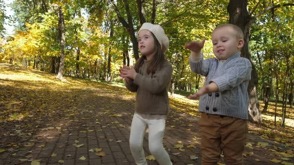 Thumbnail for Cute Children Clapping and Singing in Autumn Park