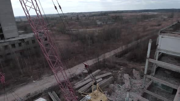 FPV Drone Flies Quickly and Maneuverable Among Abandoned Industrial Buildings and Around an