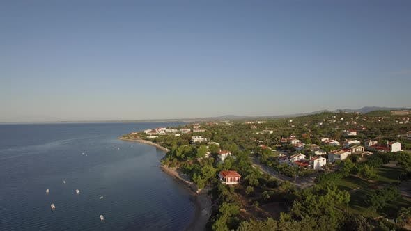 Thumbnail for Coastal Town Scene with Blue Sea. Aerial View of Trikorfo Beach, Greece
