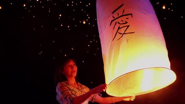 Thumbnail for Asian Woman Releases A Sky Lantern