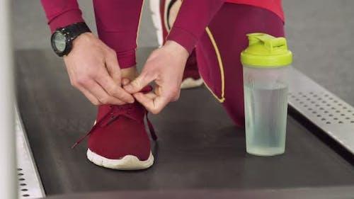 Runner Tying a Sneakers