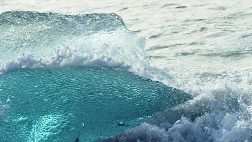 Waves Splashing on a Piece of Iceberg