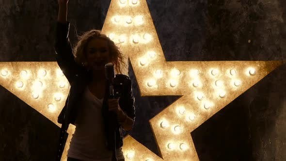 Thumbnail for Sexy Blonde, Woman Singer with Microphone, Shining Star in the Background, Slow Motion, Silhouette