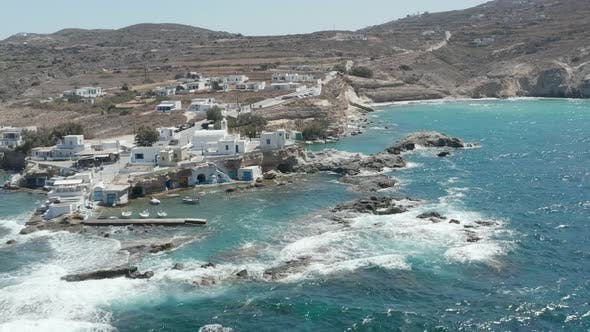 Wide Establishing Shot of Greek Fishing Village Build Right By the Ocean