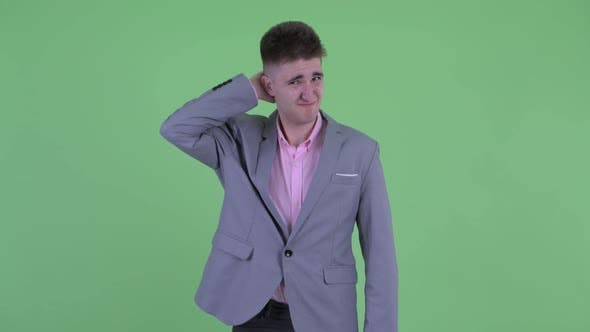 Thumbnail for Confused Young Businessman Scratching Head