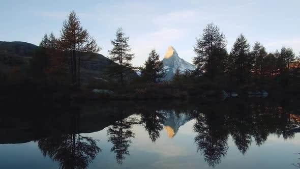 Picturesque View of Matterhorn Peak and Grindjisee Lake in Swiss Alps