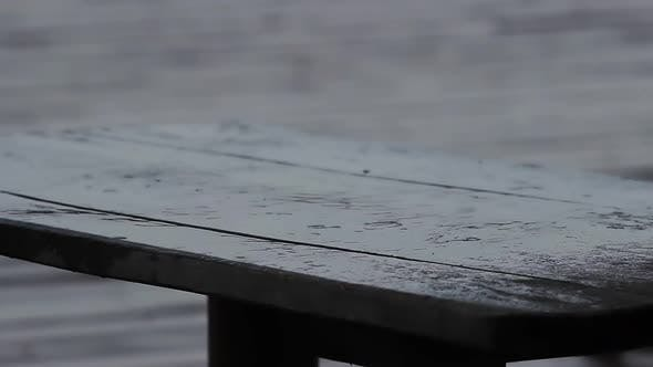 Thumbnail for Clear Raindrops Falling Down on Wooden Table. Sad and Rainy Weather, Bad Mood