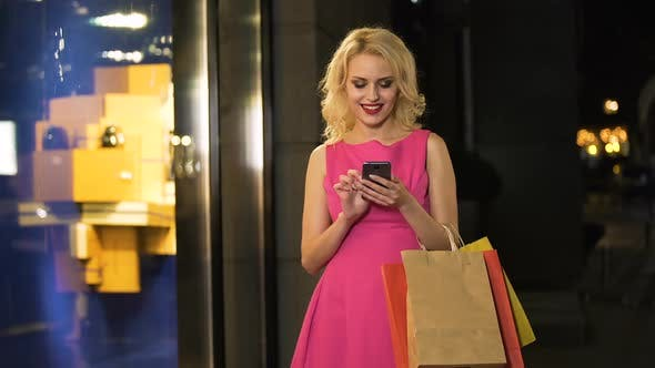 Thumbnail for Satisfied Lady Typing Message on Smartphone, Successful Shopping, Discounts